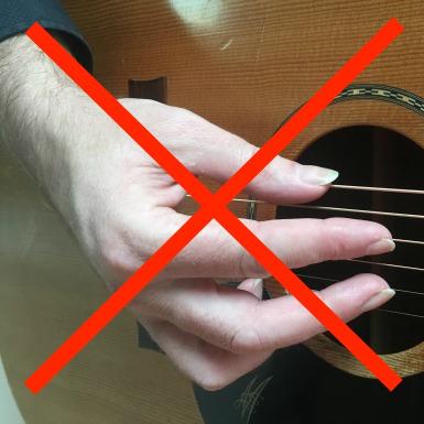 Guitar-Fingerpicking-Technique-Incorrect-Hand-Position